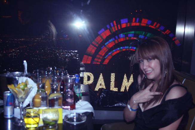 2 a.m.: A female partygoer takes a break from the New Year's Eve festivities to catch her breath and take in the breathtaking view from Moon, which is positioned on the 53rd floor of the Palms Fantasy tower.
