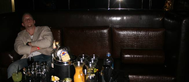 2:45 a.m.: A lone soldier guards his bounty of bottle service booze at Playboy Club.