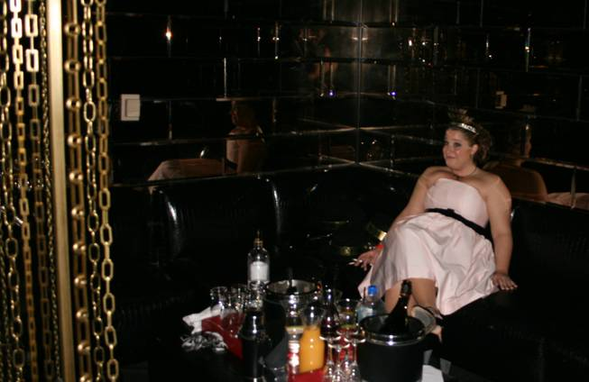 3 a.m.: A lonely party girl waits patiently at the Playboy Club as 2009 gets underway.