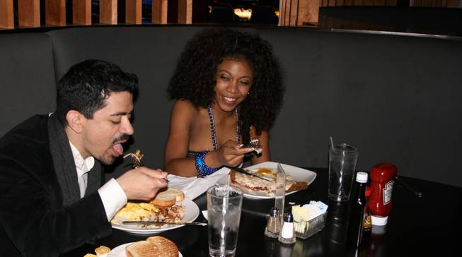 <p>4:30 a.m.: Will Rodriguez, left, and Christina Rowe, right, met on the Palms casino floor and got to know each other over an early New Year's Eve breakfast at the casino's 24/7 Cafe.</p>
