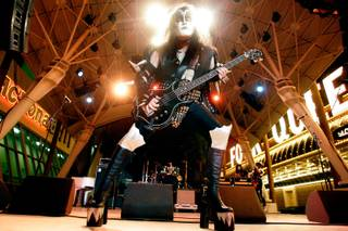 Jim Seda portrays Gene Simmons in the band The Original Kiss Army during Tribute Palooza, the New Year's Eve party at the Fremont Street Experience in downtown Las Vegas Wednesday.