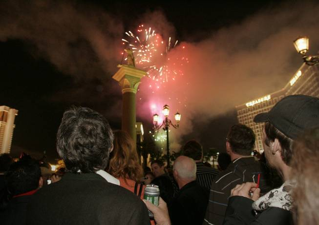 Visitors on the Strip watch fireworks while ringing in 2009 at the Venetian.