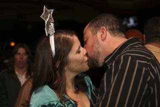 Alli Manaugh and Joe Laquitara sneak an early New Year's Eve kiss while celebrating at Quinn's Irish Pub at Green Valley Ranch Resort in Henderson New Year's Eve night.