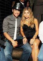 Josh Duhamel and Fergie ring in 2009.
