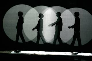 Silhouettes of the Beatles are shown during Cirque Du Soleil's Love at the Mirage Friday, Dec. 19, 2008.