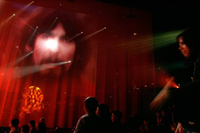 Images of the Beatles are projected on screens at the end of Cirque Du Soleil's Love at the Mirage Friday, Dec. 19, 2008.