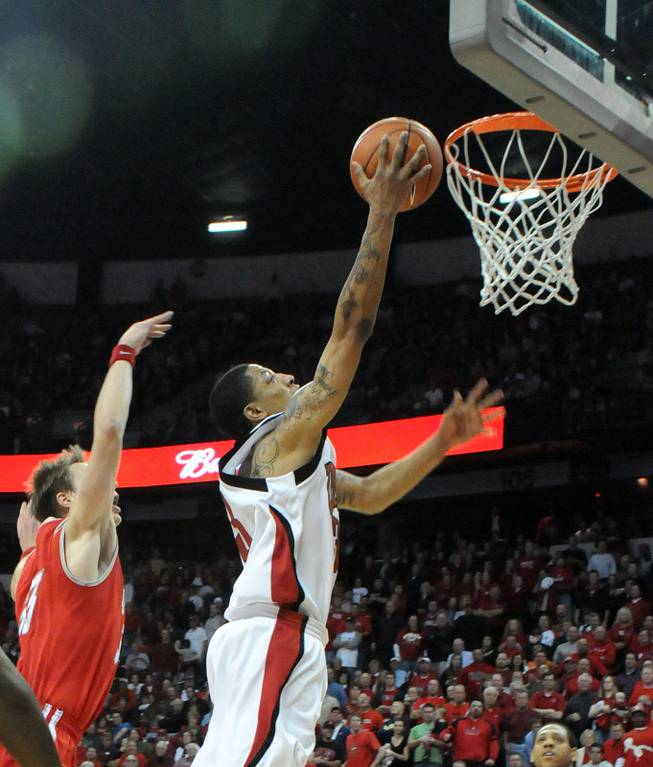 Tre'von Willis puts in a late layup Saturday at the Thomas and Mack Center as UNLV took on New Mexico.  The Rebels beat the Lobos, 60-58.
