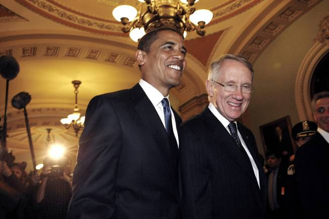 President-elect Barack Obama walks with Senate Majority Leader Harry Reid  on Capitol Hill on  Jan. 5, 2008, to a meeting with Congressional Republican and Democratic leaders.