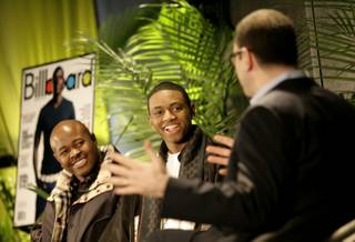 Soulja Boy (center) and his manager, Michale Croom (left), talk to Bill Werde, editorial director at Billboard magazine, about how they have used the Internet to build the Soulja Boy brand.