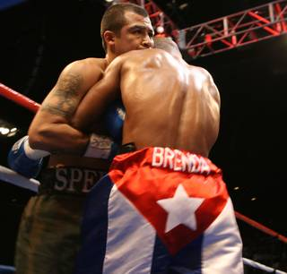 Yuriorkis Gamboa and Roger Gonzalez tangle up during their fight Friday night at Star of the Desert Arena in Primm.