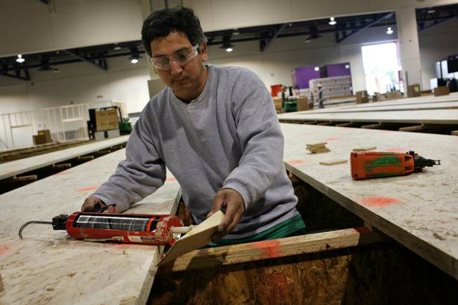 New bowling digs: At Cashman Center, Rodolfo Gonzalez works on the framework of what will be one of the largest bowling centers in Southern Nevada for the upcoming U.S. Bowling Congress Open Championships, which will run through August.