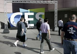 Show attendees file into the Las Vegas Convention Center in this 2009 file photo.