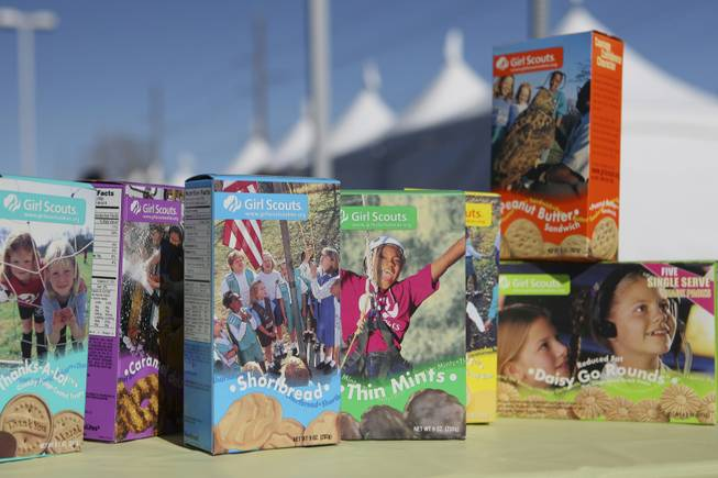 Boxes of Girl Scouts cookies sit on a table promoting the 60th cookie sale featuring the new flavor Daisy Go Rounds during the Cookie Kickoff Carnival Saturday at the Girl Scouts Frontier Council's Training and Service Center.