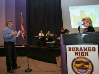 Sharon Dattoli, right, director of demographics and zoning for the Clark County School District, listens as Richard Taylor, whose child attends Sig Rogich Middle School, speaks during a public input meeting Tuesday about school attendance boundaries at Durango High School.