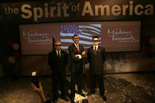 Chuck Robison, left, and D.P. Shapiro, employees at Madame Tussauds Las Vegas, pose as secret service agents with the wax figure of President-elect Barack Obama. The statue was introduced to the public Thursday as the newest addition to the wax museum.