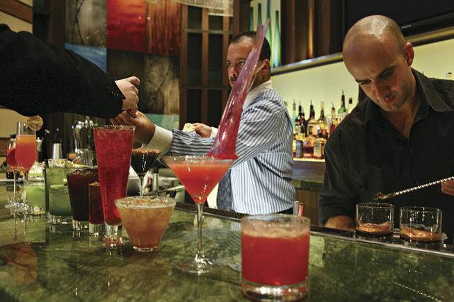 Flair bartenders Christian Oldan, left, and Juan Llorente prepare a colorful mix of cocktails at MRKT, Aliante Station's surf and turf restaurant. The presentation was part of what some say is a new focus on fine cocktails in Las Vegas, a place more well-known for freebies for gamblers and 24-hour access to alcohol.