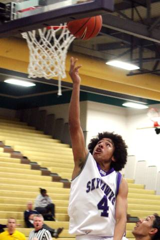 Silverado guard Ruben Jackson (4) attempts a layup during Silverado's 58-56 loss to Eldorado Friday night.