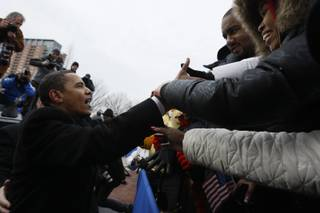 President-elect Barack Obama greets the crowd at a rally during a stop on his inaugural whistle stop train trip in Wilmington, Del., on Saturday.