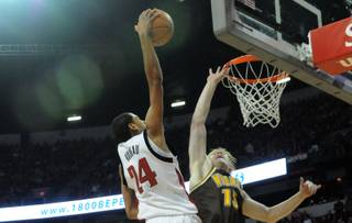 Rene Rougeau dunks over Adam Waddell of Wyoming Saturday at the Thomas & Mack Center. The Rebels beat Wyoming 83-66.