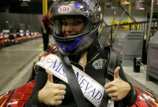 2009 Miss Nevada Julianna Erdesz gets ready for the first race of the night at Pole Position Raceway in Las Vegas on Sunday as all 52 contestants of the Miss America Pageant raced.
