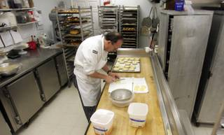 Working in the early morning, Flemming Pederson prepares basked goods at his bakery, Chef Flemming's Bake Shop.