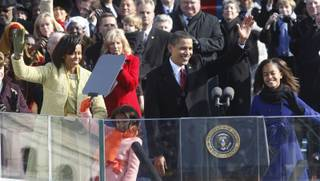 President Barack Obama, first lady Michelle Obama and their daughters, Malia, right, and Sasha, wave after Obama was sworn in at the U.S. Capitol in Washington.