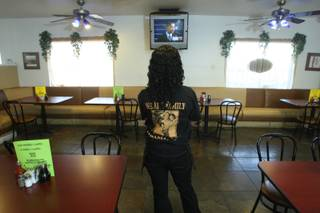 Waitress Iesha Hall watches television coverage of President Barack Obama's inauguration at the M&M Chicken and Waffles restaurant on Martin Luther King Jr. Boulevard.