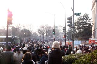 People gather on the streets of Washington, D.C. to catch a glimpse of newly sworn-in President Barack Obama Tuesday.