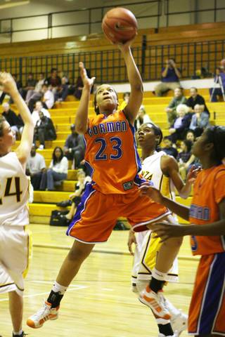 Bishop Gorman guard Yahindra Edwards goes for the basket against the Bengals at Bonanza High School on Tuesday.