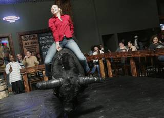 Amanda Gates rides the mechanical bull at Stoney's North Forty at Santa Fe Station.