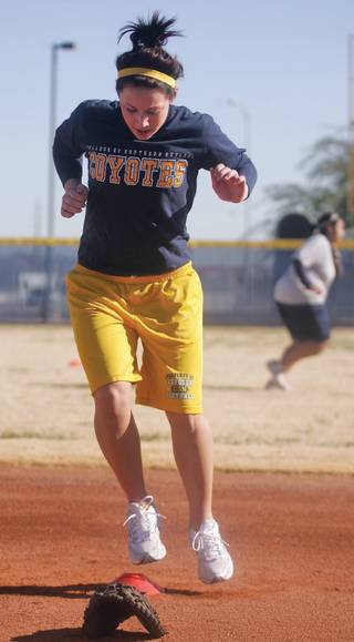 CSN's Tiffany Parker jumps from side to side during conditioning drills at CSN's softball practice at Russell Road Softball Park on Jan. 12.