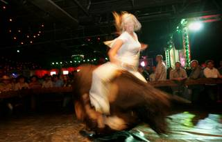 Sarah Ehlers competes Thursday in the mechanical bull riding contest Man vs. Machine at Stoney's Rockin' Country, 9151 Las Vegas Blvd.