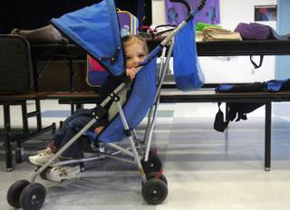 Destiny Cobian, 2, tries out a stroller at Morrow Elementary School's recycling sale Friday. Gifted and Talented Education students collect unwanted items from around the school to put on the sale. Cobian found plenty of things she would like to take home.