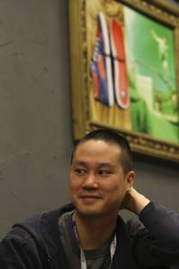 Zappos.com CEO Tony Hsieh listens during a meeting at the company's corporate offices in Henderson. Hsieh became a millionaire in 1998 at 24 when he sold his online advertising company to Microsoft. He founded Zappos.com in 1999.