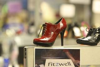 Designer shoes serve as decorations atop cubicle walls at the corporate offices of Zappos.com in Henderson.