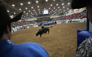 Cooper Kanngiesser of Zenda, Kan., competes during the Championship Bull Riding competition Friday at the South Point.