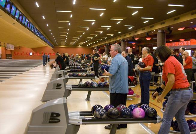 Amateur bowler Arnie Altman (center) waits for his turn during the H&R Block Tournament of Champions pro-am tournament, Saturday, Jan. 24 at Red Rock Lanes.