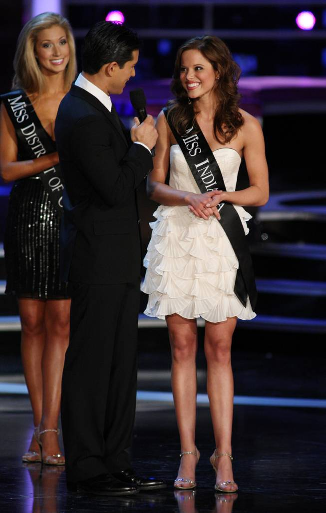 Miss Indiana Katie Stam listens to host Mario Lopez before answering a question during the 2009 Miss America Pageant in Planet Hollywood.