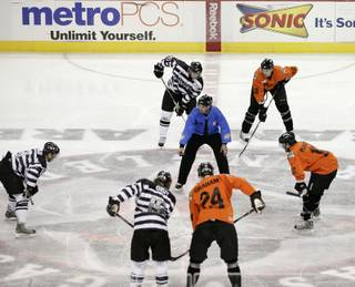 The Wranglers wear jerseys with horizontal black and white stripes while the Condors sport orange jumpsuit-style jerseys. The referees wear police outfits to fit with the theme of the night.