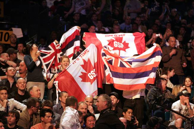 Georges St. Pierre fans, as well as B.J. Penn fans show their support for their respective fighters by waving Canadian and Hawaiian flags Saturday night at the MGM Grand before the pair's superfight at UFC 94.