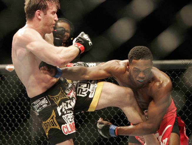 Jon Jones, right, attempts a punch at Stephan Bonnar. Jones kept his record perfect by defeating Bonnar by unanimous decision