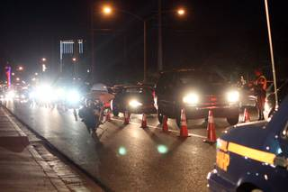 A line of cars waits to go through the DUI checkpoint on the corner of Flamingo and Lindell roads. The checkpoint was setup Sunday to nab intoxicated drivers after the Super Bowl.