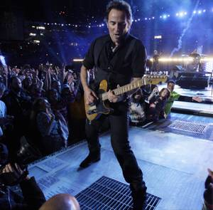 Bruce Springsteen, center, performs during the halftime of the NFL Super Bowl XLIII football game between the Arizona Cardinals and the Pittsburgh Steelers, Sunday, Feb. 1, 2009, in Tampa, Fla.