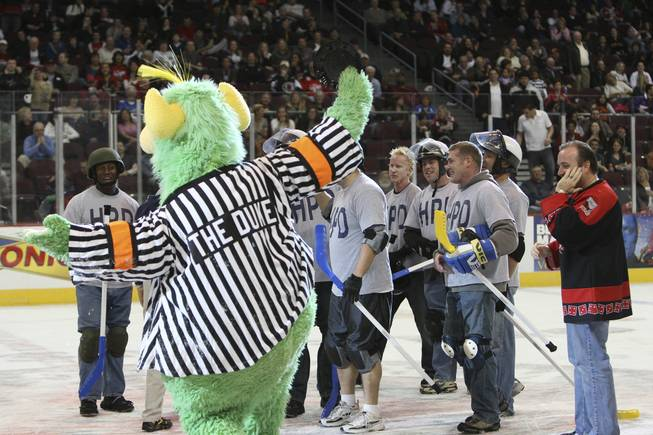 Henderson police officers celebrate with The Duke, the Wranglers' mascot, after winning the sixth annual Intermission Charity Broomball Contest 1-0 against the North Las Vegas Fire Department Feb. 2, 2009, at the Orleans Arena.