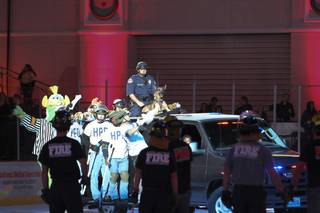 The Henderson Police Department arrives on the ice riding the SWAT truck to battle against the North Las Vegas Fire Department for the sixth annual Intermission Charity Broomball Contest during the Las Vegas Wranglers hockey game against the Bakersfield Condors Saturday at the Orleans Arena.