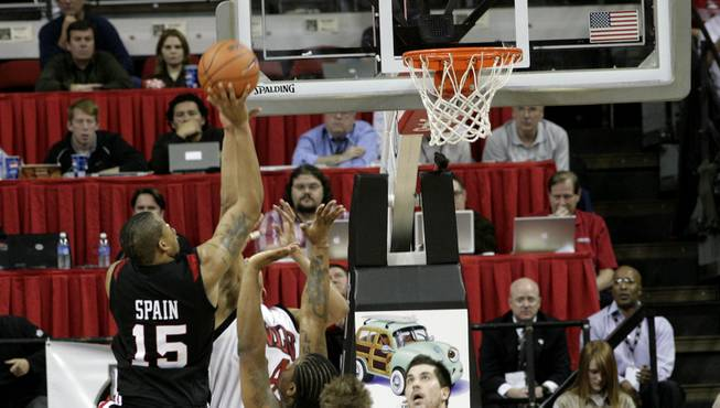Kyle Spain of San Diego State lays it in over the Rebels defense Tuesday night as the Rebels took on the Aztecs at the Thomas & Mack Center. San Diego State beat UNLV in overtime.