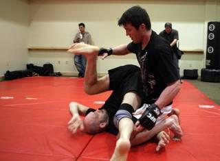 Middleweight fighter Chael Sonnen works out with Matt Lindland at the Mandalay Bay Events Center Wednesday, February 3, 2010. Sonnen will fight Nate Marquardt in UFC 109 at the events center on Saturday.