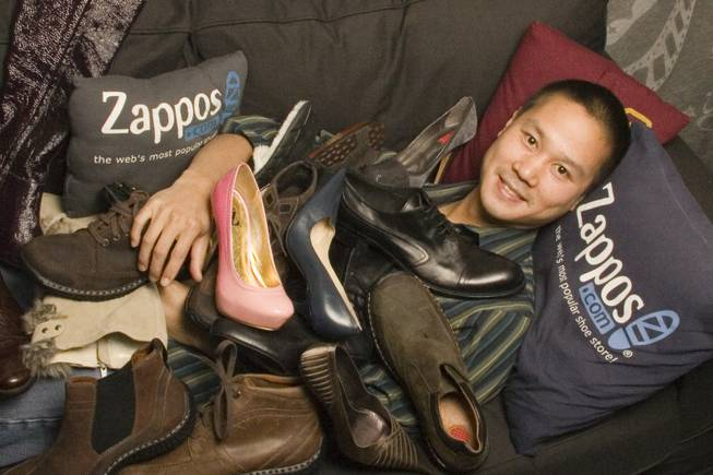 Zappos.com CEO Tony Hsieh poses with some of his company's merchandise.