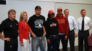 (From left) Palo Verde football coach Darwin Rost, athletic department secretary Barbara McGill, Liloa Nobriga, Sidney Hodge, Torin Harris, principal Dan Phillips and athletic department advisor Bill Kreaines pose for photos during the Panthers' National Signing Day event.