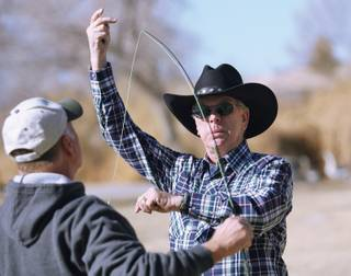 Steve White, certified fly fisherman with the Federation of Fly Fishers, demonstrates how to cast a fishing rod during a free fly fishing program at Floyd Lamb State Park on Jan. 31.